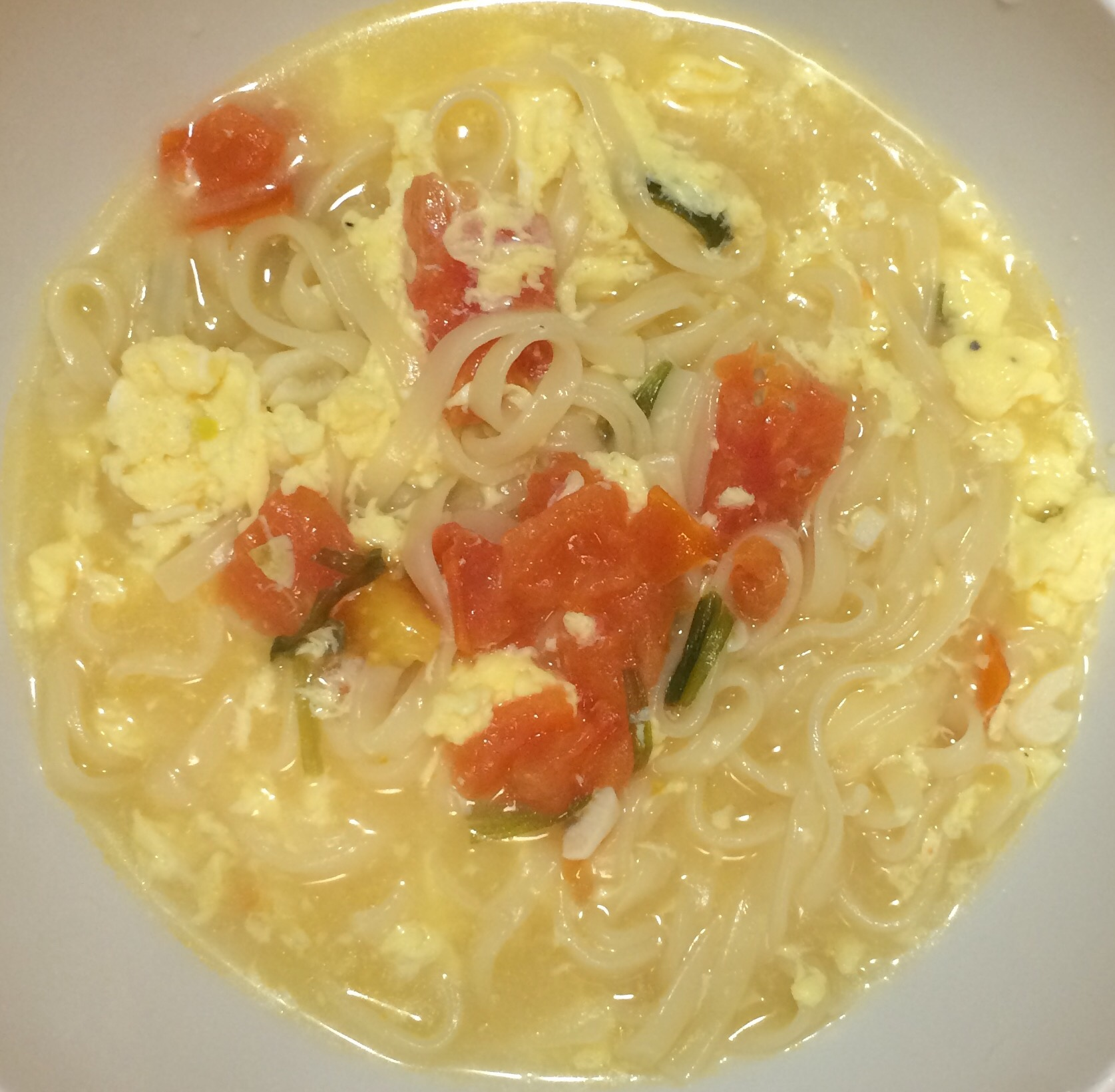 Asian noodles tomato broth soup photo